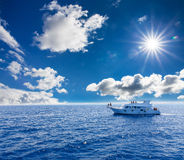 White yacht in the blue tropical sea Stock Images