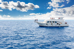 White yacht in the blue tropical sea Royalty Free Stock Photo
