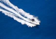 White yacht on blue water. A yacht on a blue sea water Royalty Free Stock Photo