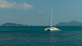 The white yacht-catamaran in the sea Royalty Free Stock Photo