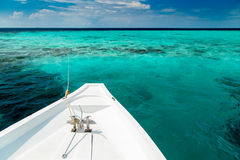 White yacht at clear ocean near coral reef Royalty Free Stock Images