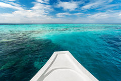White yacht at clear ocean near coral reef Stock Image