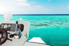 White yacht at clear ocean near coral reef Stock Photos