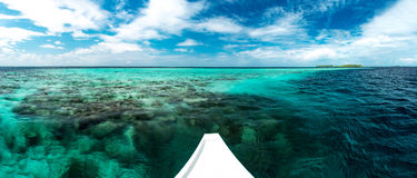 White yacht at clear ocean near coral reef Royalty Free Stock Image