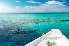White yacht at clear ocean near coral reef Royalty Free Stock Photography