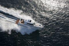 White yacht dashing through the ocean Stock Photography