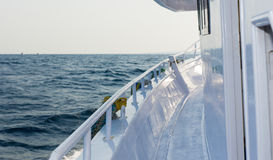 The white yacht deck during sailing on a beautiful blue sea Stock Photography