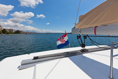 The white yacht floats by the blue sea in Croatia Stock Image