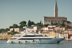 White yacht in front of Rovinj walls Royalty Free Stock Images