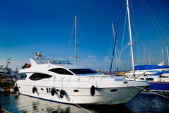 The white yacht in harbour Stock Images