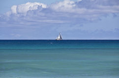 The white yacht on the horizon of the Indian Ocean Stock Images