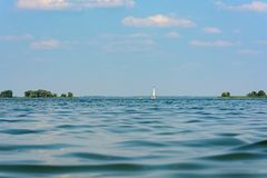 White yacht on the horizon of the river. Summer weather Stock Photography