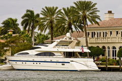 White Yacht by Mansion on Canal Royalty Free Stock Photo