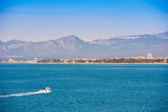 White yacht on mediterranean sea, Costa Dorada, Tarragona, Catalanya, Spain. Blue sky. Copy space. Stock Images