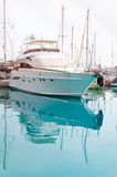 White yacht in a moorage. With clean blue water Stock Image