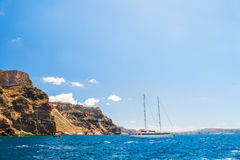 White yacht near the Santorini island, Greece Royalty Free Stock Image