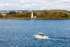 White Yacht Past White Halifax Lighthouse Stock Images