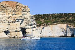 Sailing yacht on the sea. White yacht with people near Milos island, Greece Royalty Free Stock Photos