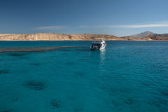 White yacht in the Red sea with blue water. Reef for snorkeling Stock Images