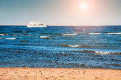 White yacht in the Red sea at sunset Royalty Free Stock Photo