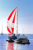 White yacht sailing. Small white yacht sailing in sunny day royalty free stock images