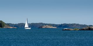 White yacht sailing on the Bay. In the archipelago in Finland Stock Photography