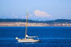 White yacht sailing in blue ocean Stock Photography