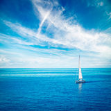 White Yacht Sailing in Blue Sea Stock Photography