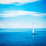 White Yacht Sailing in Calm Blue Sea Royalty Free Stock Photography