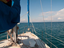 White yacht sailing on calm sea Stock Photography