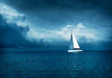 White Yacht Sailing in Stormy Sea. Dark Photo. Royalty Free Stock Image