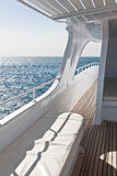 White yacht on the sea. View of the sea from a yacht main deck Royalty Free Stock Photography