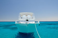 White yacht in sea. White yacht in the blue sea, front view Royalty Free Stock Photo