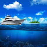 White yacht in the sea. Island with palm trees on the horizon. T. Urtle under water Stock Photography