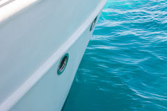 White yacht side. Above blue water surface Stock Images