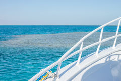 White yacht side. Above blue water surface Stock Image
