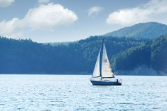 White yacht on Solina lake Royalty Free Stock Image