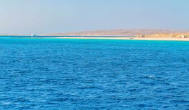 White yacht on a sunny day on the red sea surrounded by clear blue water royalty free stock photo