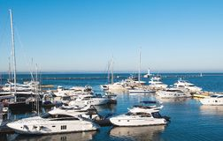 White yachts in the port waiting. Stock Images