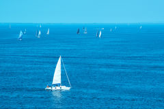 White yachts sailing at sea Stock Photos