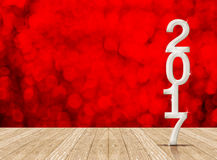 White 2017 year number in perspective room with red sparkling bo Royalty Free Stock Photo