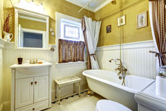 White and yellow antique bathroom interior Stock Photo