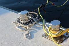 Nautical ropes with shiny mooring bollards stock photography