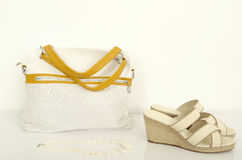 White and yellow bag with matching wedge sandals. Stock Photos