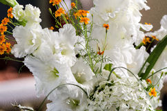 White and yellow flowers in the wedding floral decorations. Royalty Free Stock Images