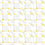 White and yellow geometrical perforated leaves and rhombuses sea Stock Photos