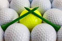 Golf balls and tees. White and yellow golf balls and different tees Stock Images