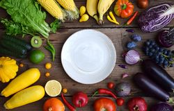 White, yellow, green, orange, red, purple fruits and vegetables on wooden background. Healthy food. Multicolored raw food royalty free stock photos