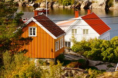 White and yellow house near fjord Kragero, Portor Stock Photos
