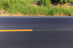 White and yellow line on new asphalt road Royalty Free Stock Image